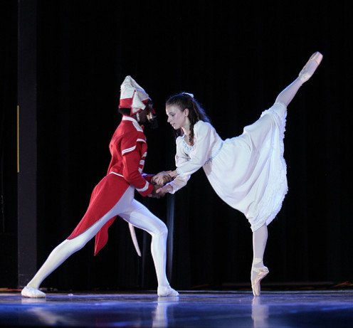 Clara dances with the Nutcracker.