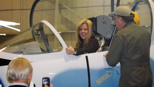 An attendee having some fun in the cockpit of the L-39.