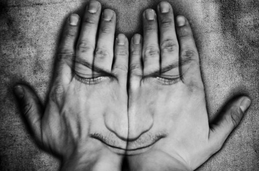Hands covering face by: George Hodan