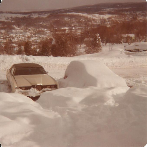 Our next residence at Highgate Apartments high on Berlin Street overlooked the small city of Barre, Vermont. Buried, here, next to the Ford and awaiting dig-out is the little red Datsun in which my two children and I traveled the state.