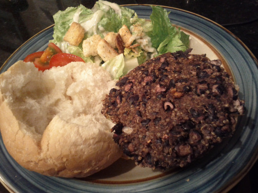 Black Bean and Quinoa Burger served with Kaiser bun and Caesar salad