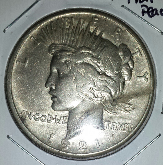 My 1921 Peace Dollar (obverse). It has a smudge across it, but in my opinion, a beautiful coin nonetheless.