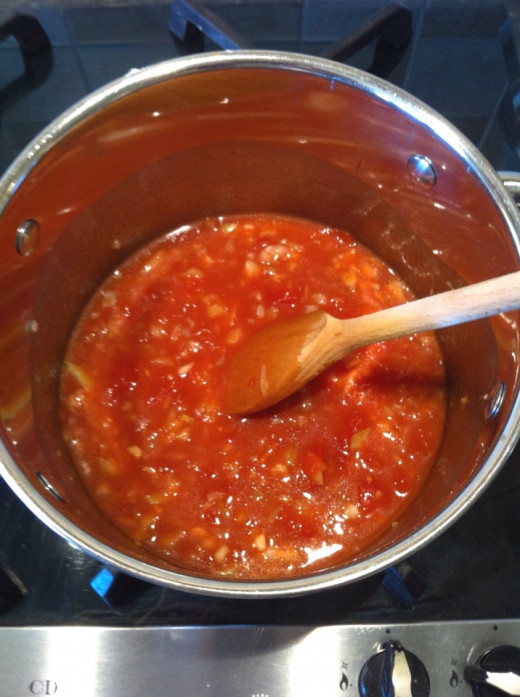 Add the can of tomato's, stock, Worcestershire sauce, seasoning, and bring to the boil