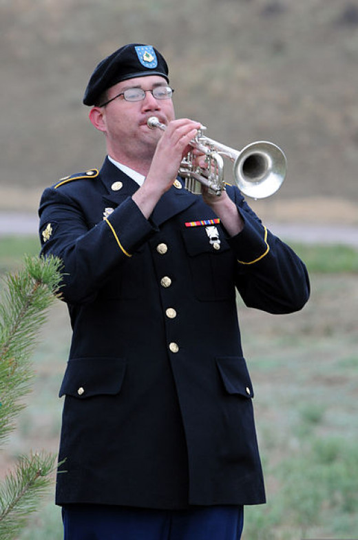 File: U.S. Army Spc. Michael Darcy, bugler, 4th Infantry Division Band, plays taps in remembrance of fallen warriors during Mountain Post Warrior Memorial Ceremony at Kit Carson Park, Colo., May 23 130523-A-QF214302.jpd