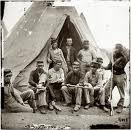 Troops lounge outside their Sibley Tent