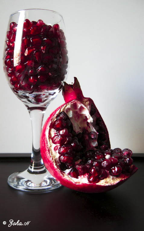 The deep ruby red of pomegranates make them ideal for a centerpiece. Pile seeds in a glass like jewels.