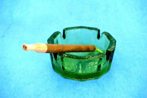 stick of cigarette  in a small bowl
