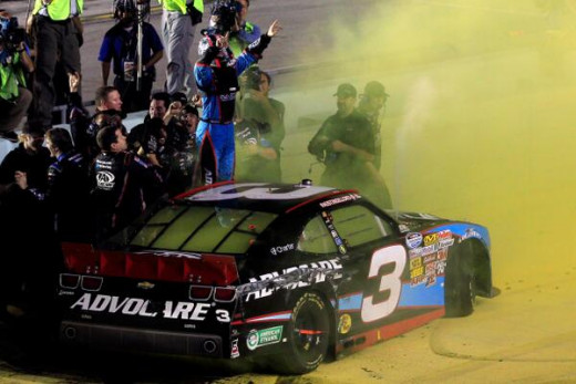 Austin Dillon celebrates his championship, appropriately with yellow smoke