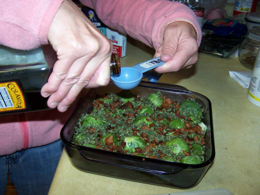 Using a tablespoon measure out two tablespoons and add to the brussel sprouts .
