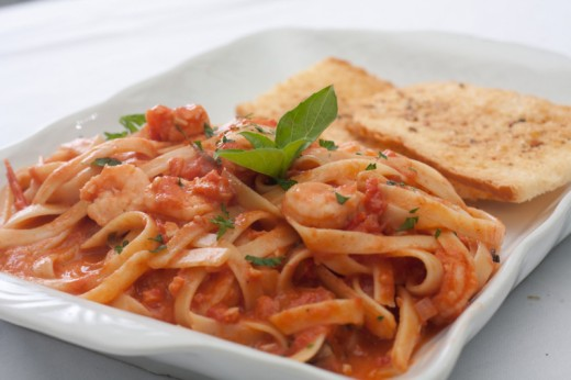 If you love seafood fettuccine then your going to love the twist I have added to this tasty treat making a tomato cream sauce in the place of a regular cream sauce just takes it up anther notch.