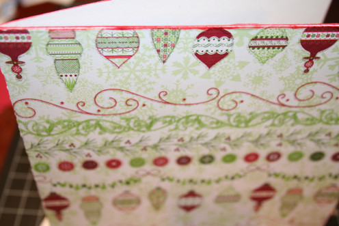 Ink the edges of the card, except for the crease on the left side, with a rubber stamp ink pad.