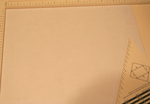 Trim a piece of 12 x 12 patterned paper to size 10 x 10.  Set your measurements to 5 1/2 around each side.  The fold.