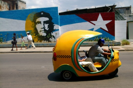 A famous yellow coco-taxi in Cuba