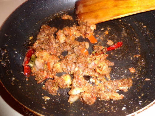 All the masala powders are added in the pan and mixed well with rest of the ingredients