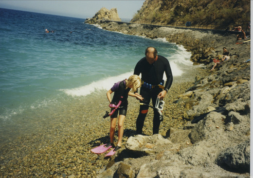 My daughter, Julie, and I prepare to enter the water and snorkel at Avalon, CA, 1995.
