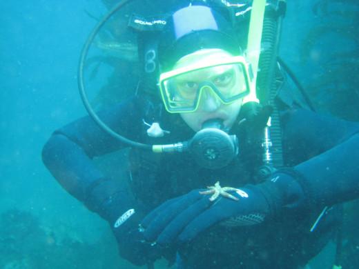 My son, Dan, examines a juvenile sea star at Casino Point, Avalon, CA - 2009
