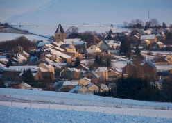 The village of Cheveuges under snow