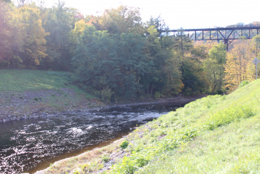 A view of the Rosendale Walkway across the Railroad bridge with the Rondout Creek beneath.