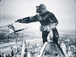King Kong battles biplane atop the Empire State Building