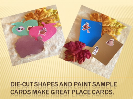 Die-cuts can be made or purchased at craft stores.  Paint sample cards are free and found at hardware and paint stores.