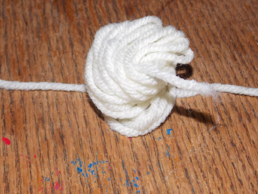 Lay the bunch on the length of yarn.