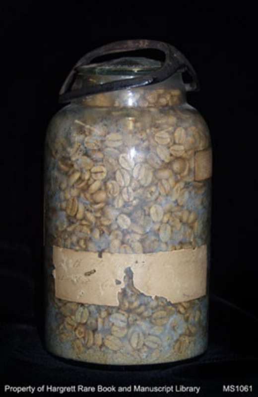 A glass jar of coffee beans