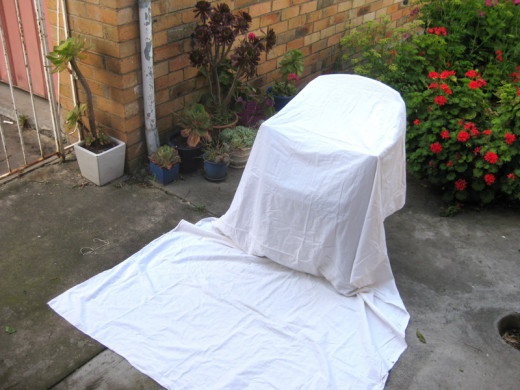 My homemade backdrop made out of a garden chair and a white sheet.