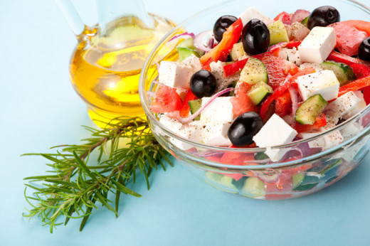 An example of using props. In this case, the photographer used fresh rosemary and olive oil with a plain background.