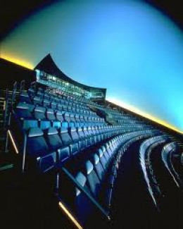 Traditional IMAX seating as found in Museums such as the Boston Museum of Science and Technology.