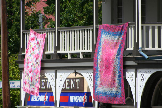 Traditional style buildings are the perfect backdrop for traditional style quilts.