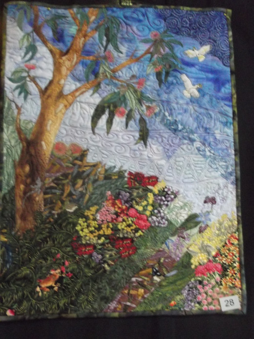 This is one of the quilts displayed at the 2013 quilt exhibition in Braidwood, NSW. Featuring a gum tree and white cockatoos, it is uniquely Australian.