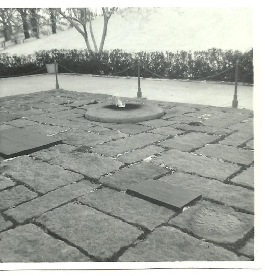 Gravesite of President John F. Kennedy, including the eternal flame, as photographed  in 1968.