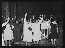 Early Pentecostal women in worship. These women believed in fervent prayer and were liberated by the Holy Spirit to hold positions denied to most women.