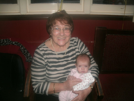 Mum, nursing her latest great grandchild in November 2013