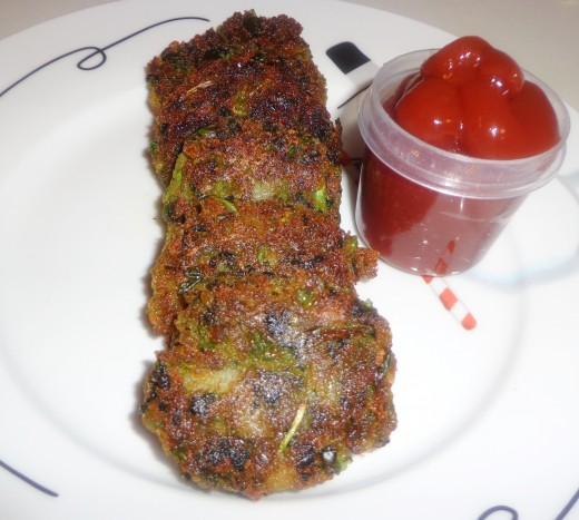 Spinach Mutter Cutlets or Hara Bhara Kababs are ready to serve with Tomato sauce.