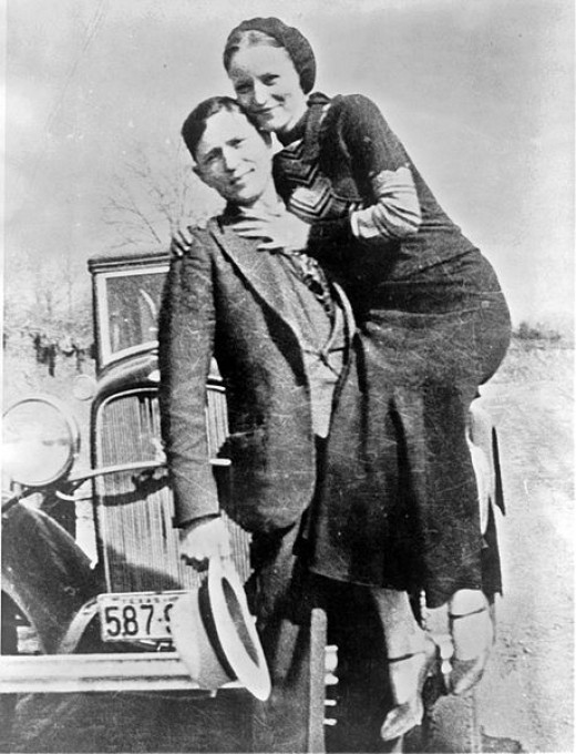 Bonnie Parker and Clyde Barrow, sometime between 1932 and 1934, when their exploits in Arkansas included murder, robbery, and kidnapping. Contrary to popular belief the two never married. They were in a long standing relationship. Posing in front of