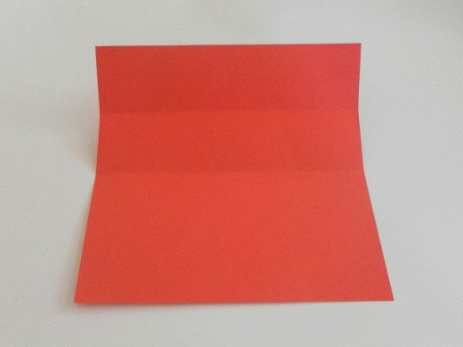 Unfold the paper. You should get another crease line near the top.