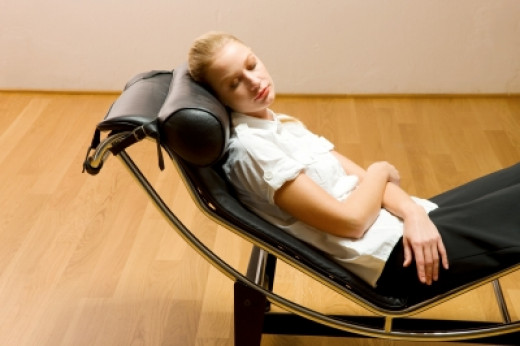 You don't have to sleep in a chair.  You can sleep comfortably in your own bed with a bed wedge.