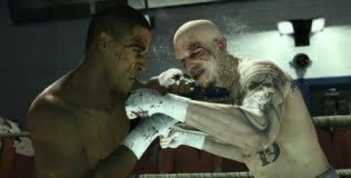As the scene shows, In story mode you leant the fight game while locked behind bars. The boxers box bareknuckle style.