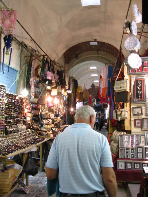 Tourist shopping in the old bazaar in Tunis, Tunisia