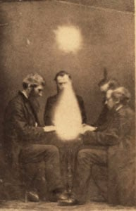A seance conducted by a medium.