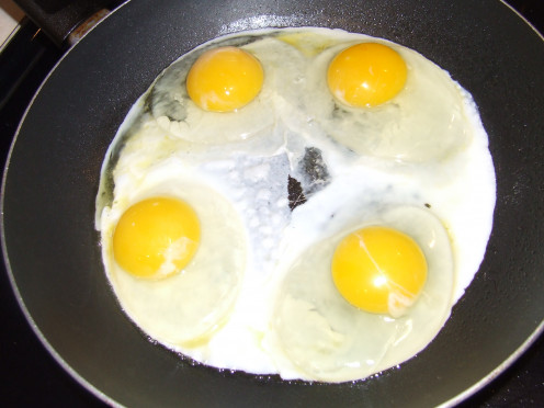 Prepare Eggs Over Easy. Make sure to spray the pan so that the eggs don't stick. You can also add margarine for flavor.