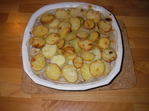 Spread the sliced boiled potatoes all over the dish
