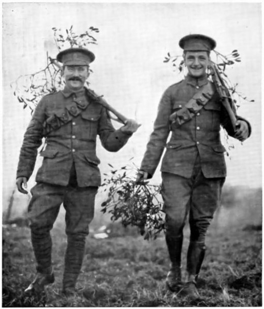 Two British soldiers carry some mistletoe to the front line