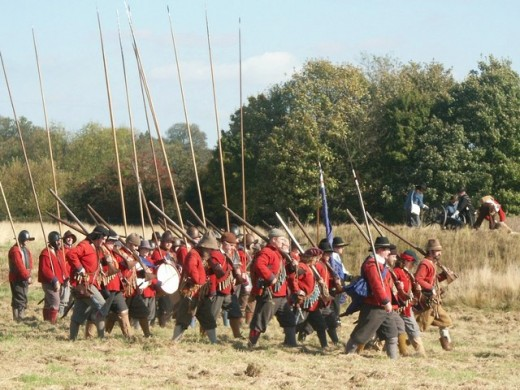 The New Model Army, formed in 1645 by Parliament, was England's first professional army. The foot regiments consisted of pikemen and musketeers, and were provided with the distinctive red tunics shown here.