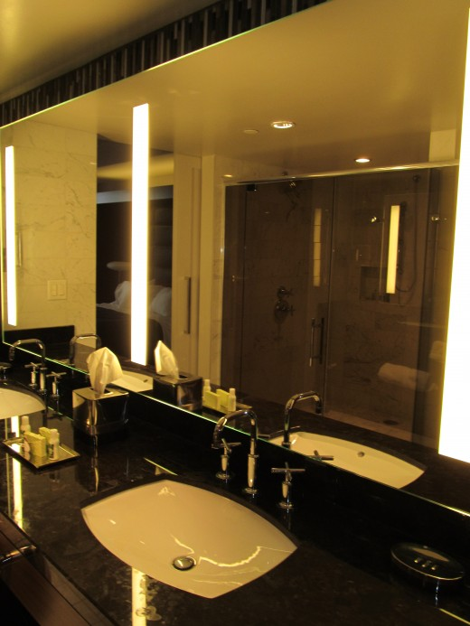 Glamorous lighted mirrors, tons of marble and beautiful smoked glass doors at THE D