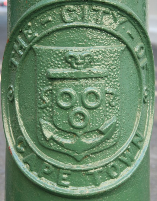 A Cape Town City crest on a bollard at the entrance to Parliament Lane