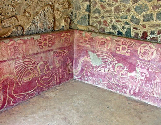 Each jaguar is holding a trumpet made of a snail's shell on this ancient Mesoamerican wall.