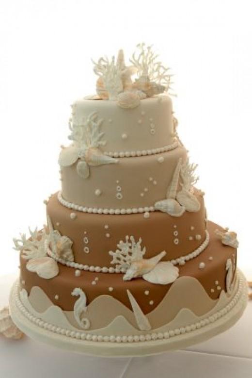 a beach-themed wedding cake