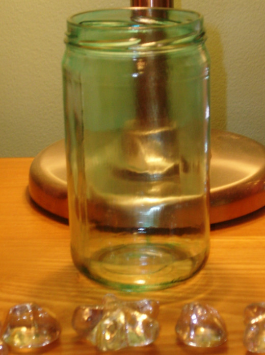 You can use almost any wide mouth jar to be used as a candle holder.
